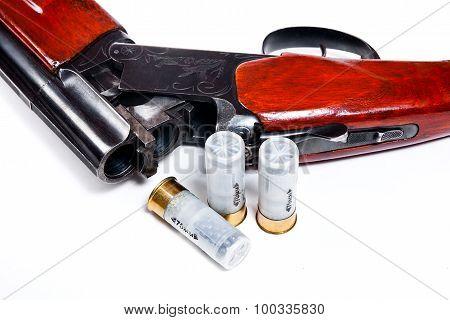 Hunting Shotgun And Ammunition On White Background.