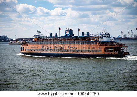 NEW YORK CITY, USA - SEPTEMBER, 2014: Staten island ferry leaving downtown Manhattan