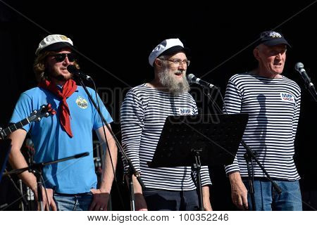 ST. PETERSBURG, RUSSIA - AUGUST 15, 2015: Shanti choir of the sailing ship Mir participate in the Sea Music festival during the International marine festival