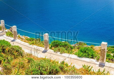 Stairs to the beach with clear water, Greece