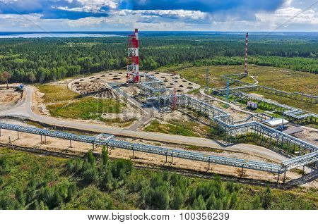 Tyumen, Russia - August 27, 2015: Bird eye view onto torches for burning of associated gas of Antipinsky oil refinery poster