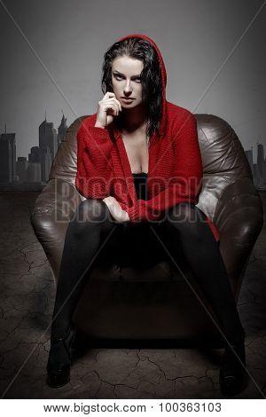 Sexy Woman In Desert Sitting On Sofa