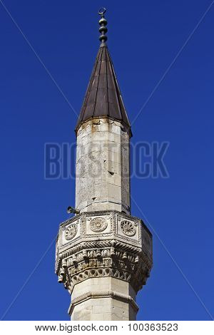 High stone minaret on the territory of Bakhchisarai Palace in Crimea poster