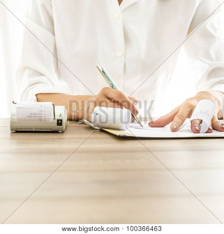 Front View Of Female Bank Employee Writing Something On Receipts