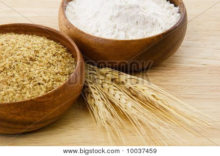 Two Wood Bowls With Flour And Wheat Germ