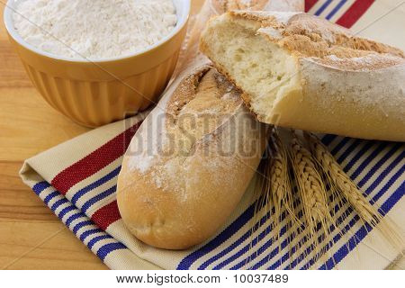 Delicious Crusty Baguette Bread On A Red White And Blue Towel