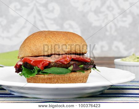 Portobello Mushroom Burger With Roasted Red Pepper, Basil, Greens And Melted Cheese.