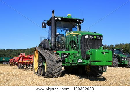John Deere 8345RT Track Tractor And Vaderstad Cultivator On Field