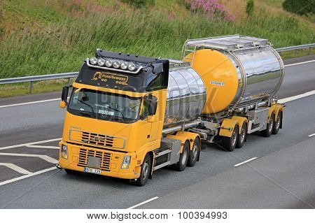 Yellow Volvo Fh Tank Truck Transports Food On Motorway