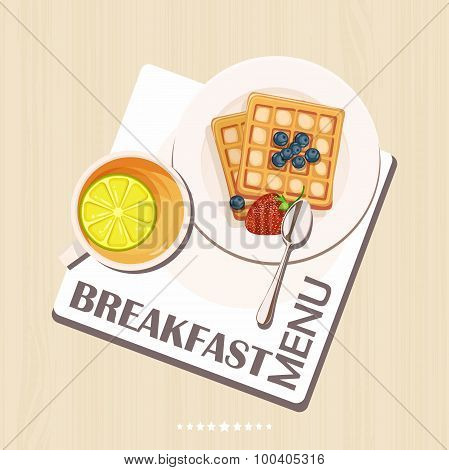 Breakfast set with tea, lemon, belgian waffles.