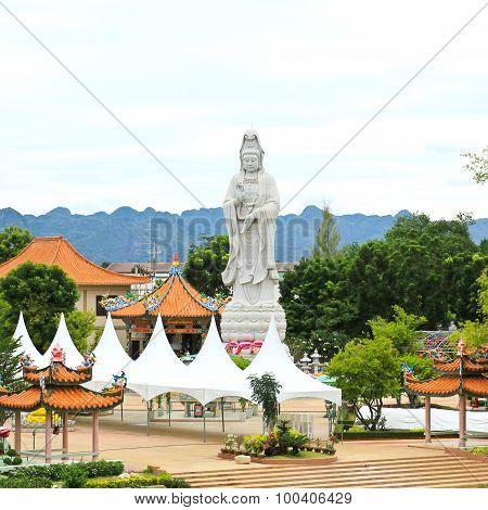 White Marble Quan Yin Stand Near The Bridge Of The River Kwai ,kanchanaburi ,thailand.