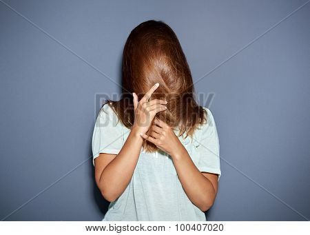 Fun Portrait Of A Woman Hiding Behind Her Hair