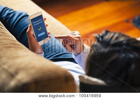 Woman Using On Line Banking On Mobile Phone At Home. Blue Screen.