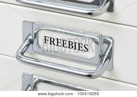 A Drawer Cabinet With The Label Freebies
