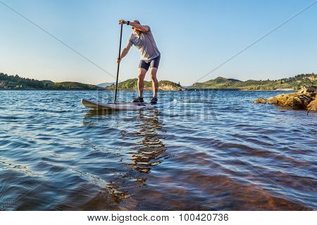 stand up paddling workout on Horsetooth Reservoir at foothills of Rocky Mountains near Fort Collins, Colorado, summer scenery