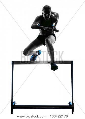 one  caucasian woman hurdlers  hurdling in silhouette isolated white background