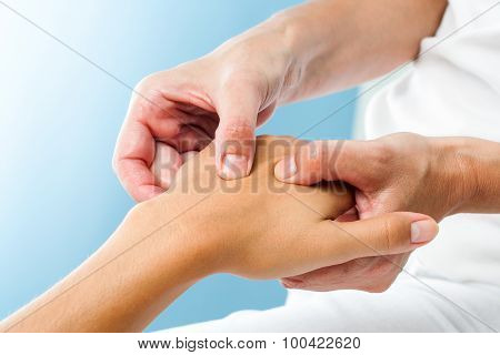 Therapist Doing Massage On Female Hand.