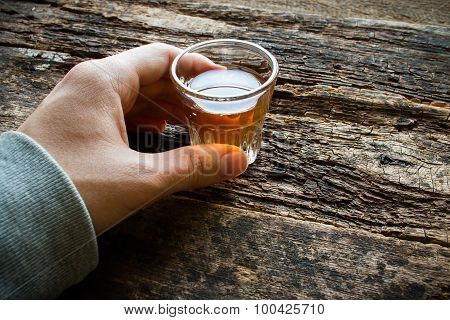 Man Holding A Glass Of Alcohol