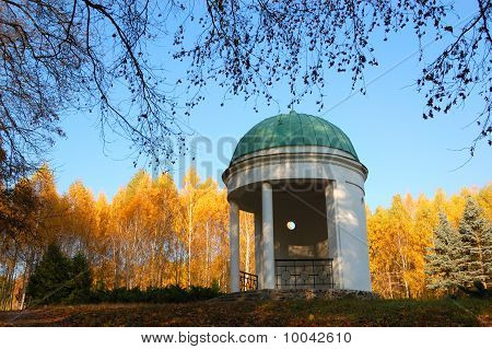 Pavilion in a park with yellow birch trees and blue sky on background Ukraine poster
