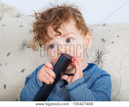 Baby Boy With Remote