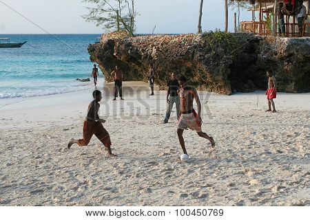 African Teens Playing Beach Football On The Banks Indian Ocean.