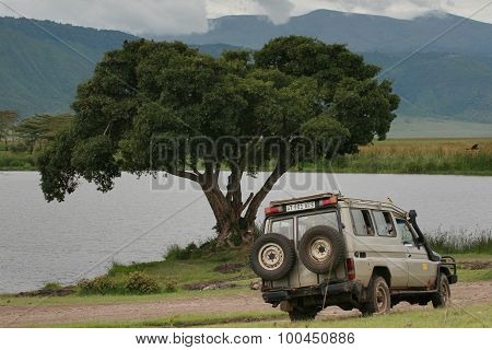 Old Jeep For Tourists, Parked Near Forest Lake, Ngorongoro Crater.