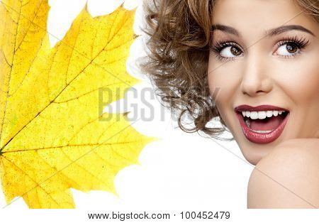 portrait of attractive  caucasian smiling woman blond isolated on white studio shot red  lips toothy smile face head and shoulders yellow maple leaf