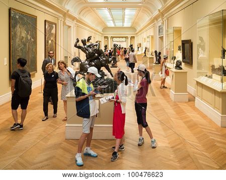 NEW YORK,USA - AUGUST 14,2015 : Visitors admiring sculptures by Auguste Rodin and paintings at the Metropolitan Museum of Art in Manhattan
