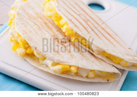 breakfast - two tortillas or wraps with eggs and cheese toasted in panini press