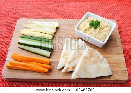 Carrot, cucumber and corn sticks with pita bread and humus/hummus
