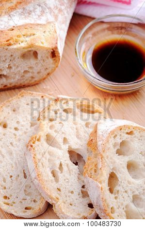 Common Italian appetiser; sliced baguette served with olive oil and balsamic vinegar