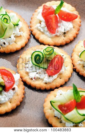 Bite size canapes with cottage cheese, zucchini and tomato