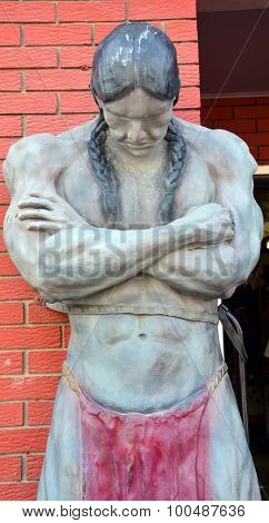 Strong indian man wood statue