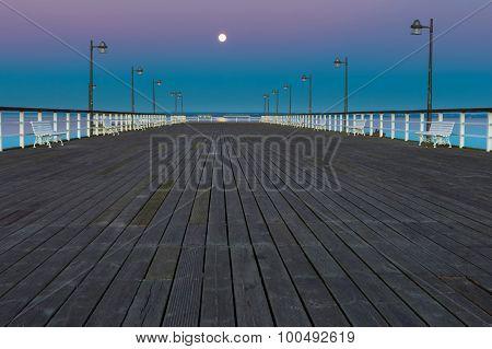 Beautiful wooden pier on Baltic sea shore. Wooden molo in Jastarnia on Hel peninsula. poster