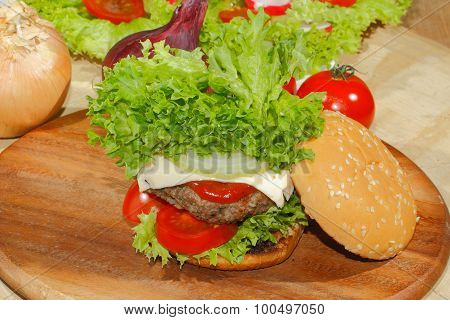 Hamburgers fast food burger hamburger steak with salad tomato cheese cucumber on a wooden chopping board poster