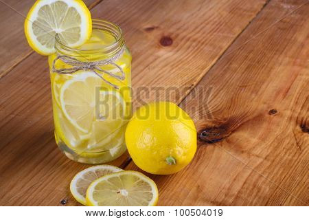lemon with glass jar
