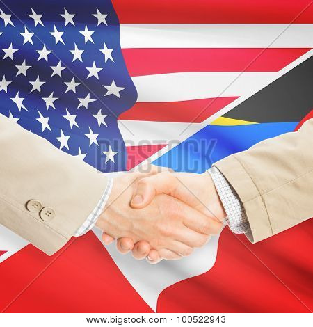 Businessmen shaking hands - United States and Antigua and Barbuda poster