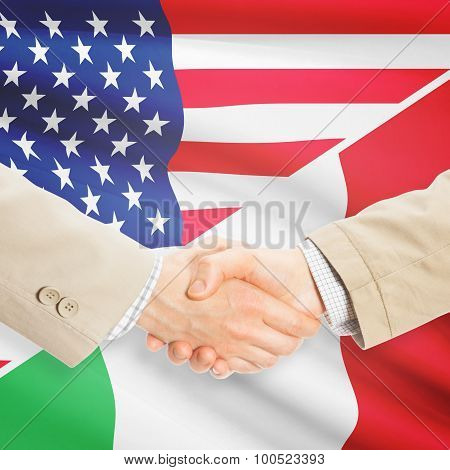 Businessmen shaking hands - United States and Italy poster