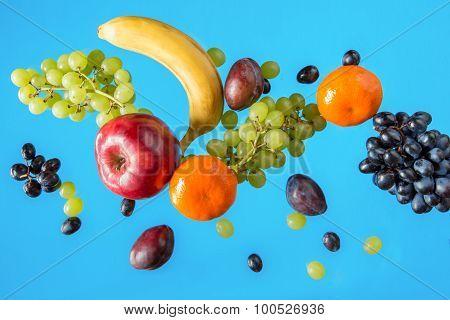 Fresh Fruits On A Blue Background.