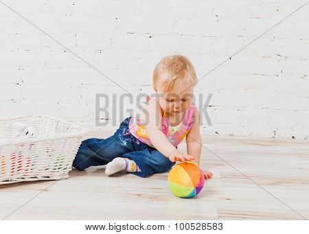Little baby girls playing with ball