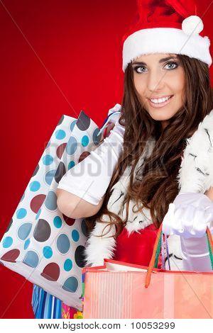 Sexy Santa Woman Holding  Shopping Bags