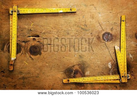Vintage wood table with two yardsticks