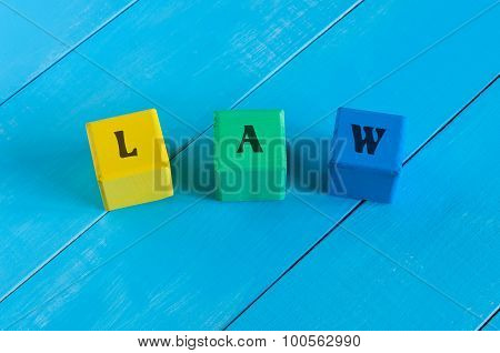 Law - word in vintage wooden colourful blocks. Business background