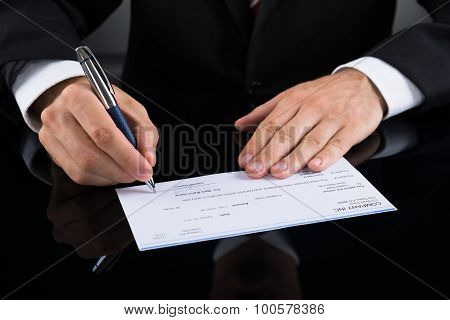 Businessperson Signing Cheque