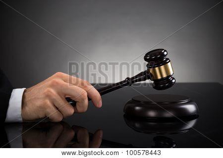 Close-up Of Judge Hitting Gavel