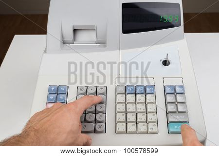 Person Hands On Cash Register