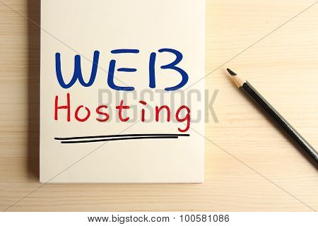 Text Web hosting with underline on the notebook with a pencil aside. poster