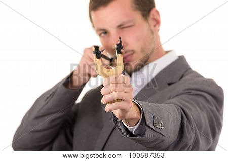 Handsome buisness man concentrated aiming a slingshot isolated over white background. poster