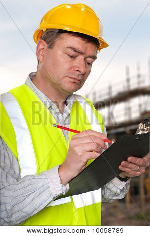 Construction Foreman Checks Clipboard