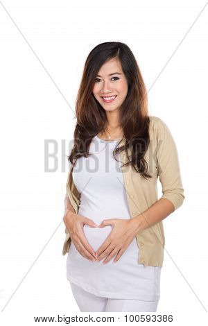 Pregnant Asian Woman Touching Her Big Belly Happily, Heart Shape Hand Gesture